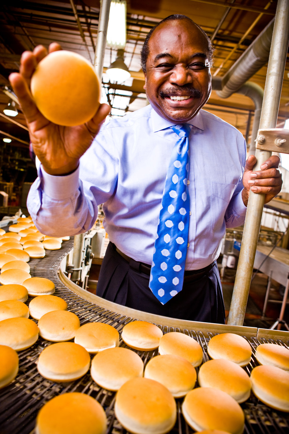Portrait of Alum Tilman Brown owner of New Horizons Baking Co. in Norwalk, OH