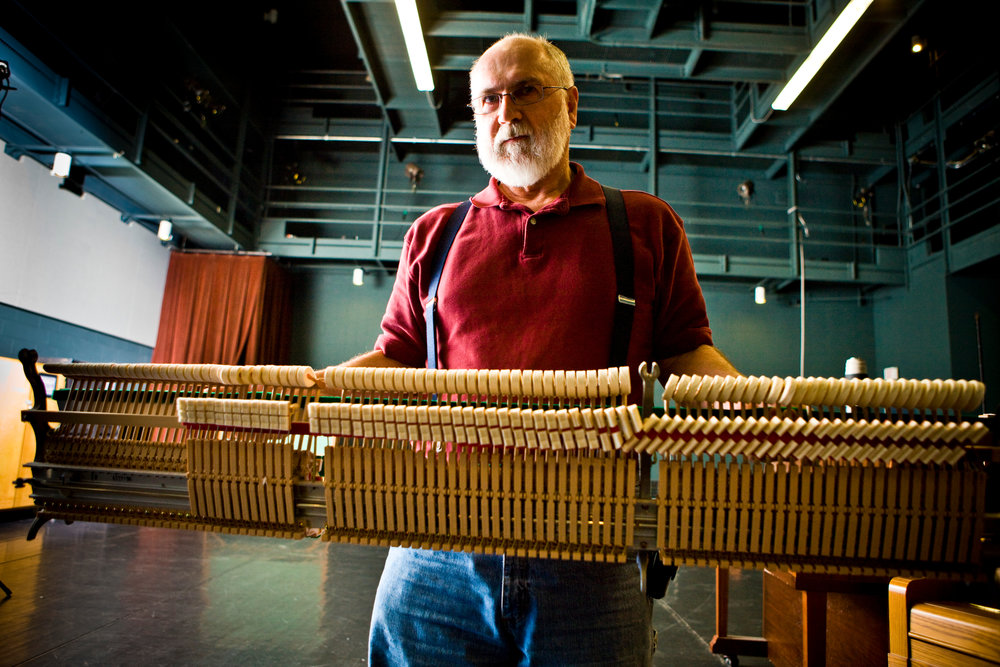 Portrait of Piano Tuner Gary Shipe working in Slee Hall
