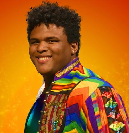 Joseph on orange background.jpg