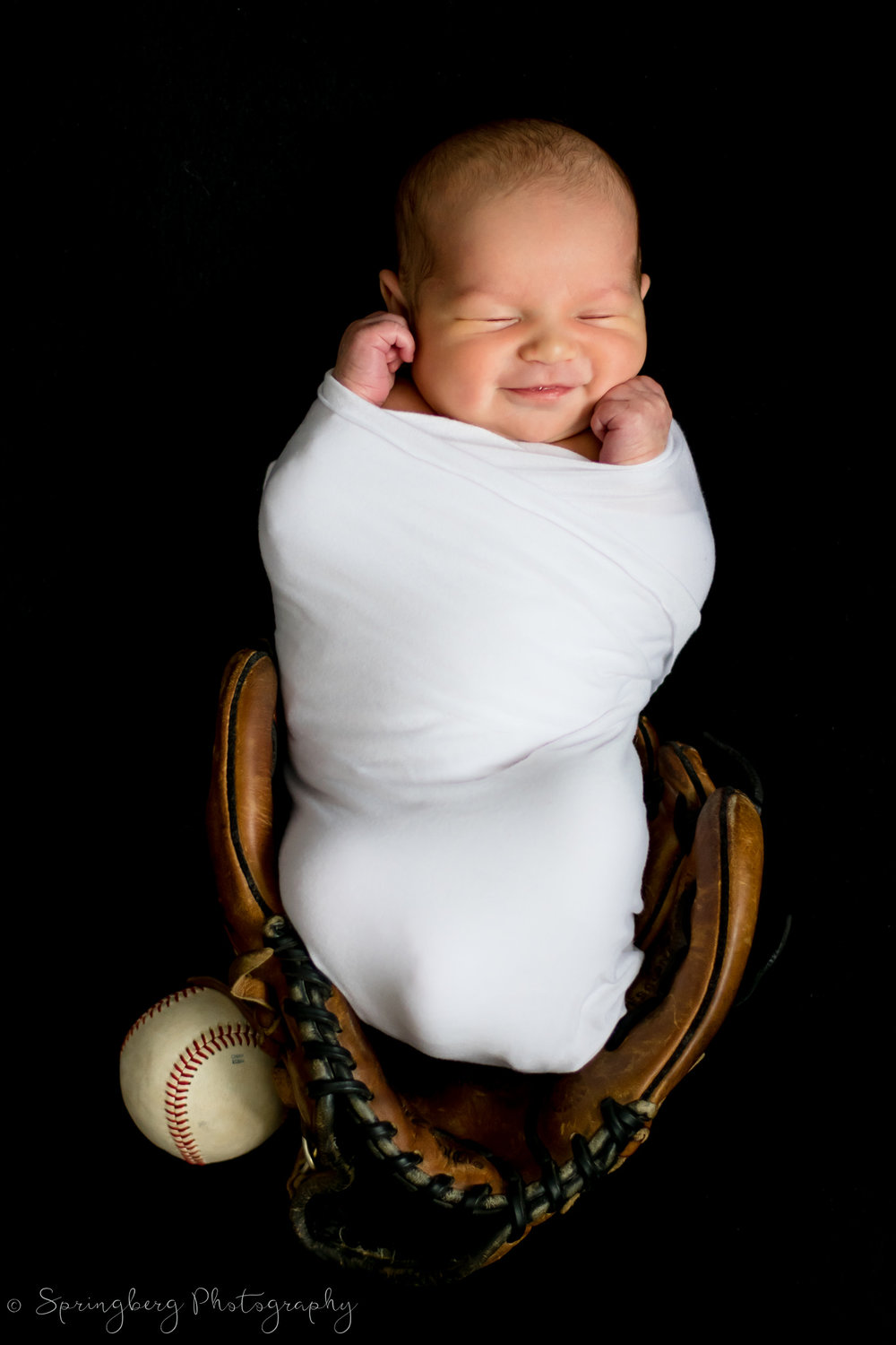 Baby's parents had a baseball theme for their wedding and wanted to incorporate their love for the sport into their newborn session, too!