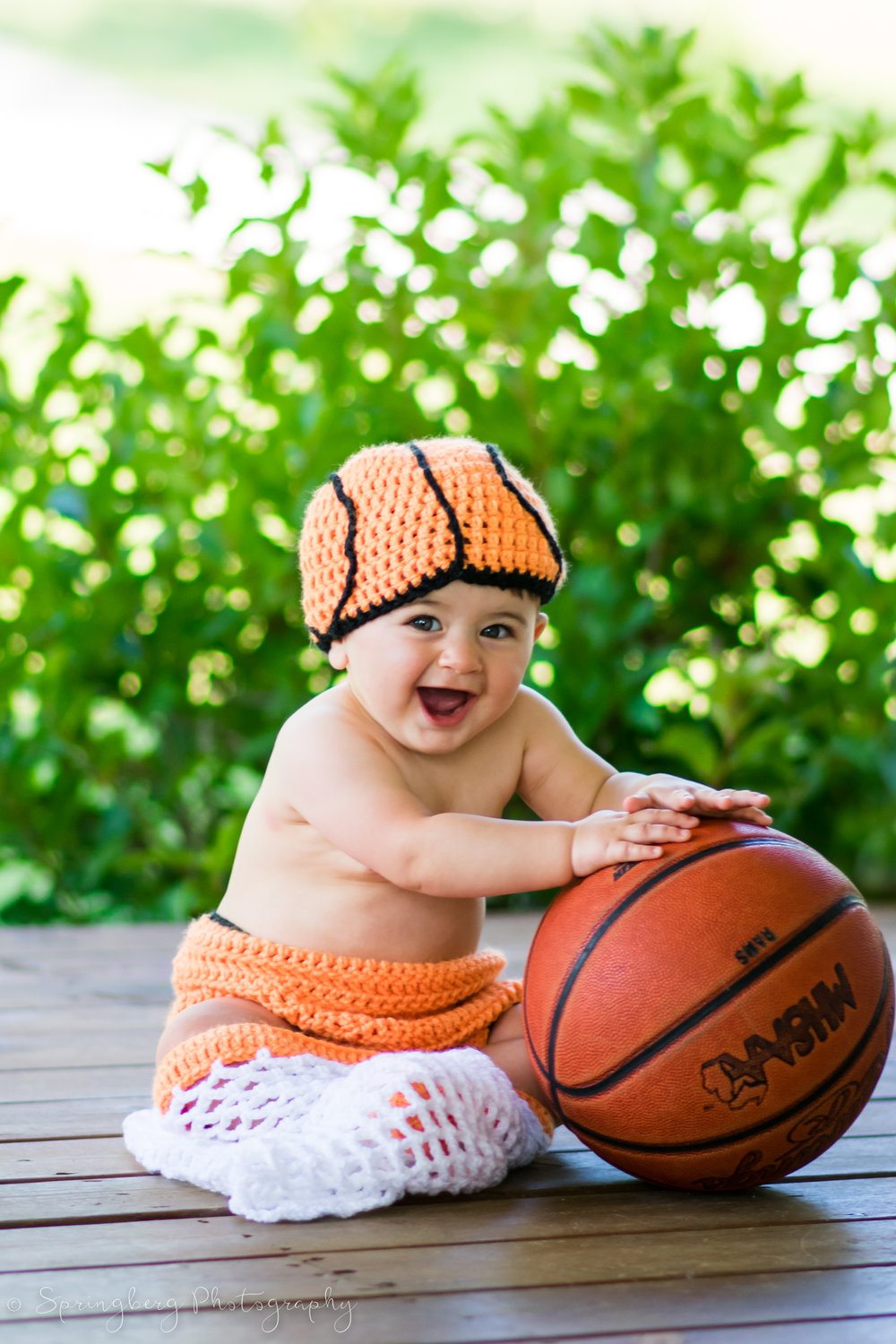 This little guy's parents are both involved in their school's basketball teams, so they wanted to incorporate their interests into their family session!