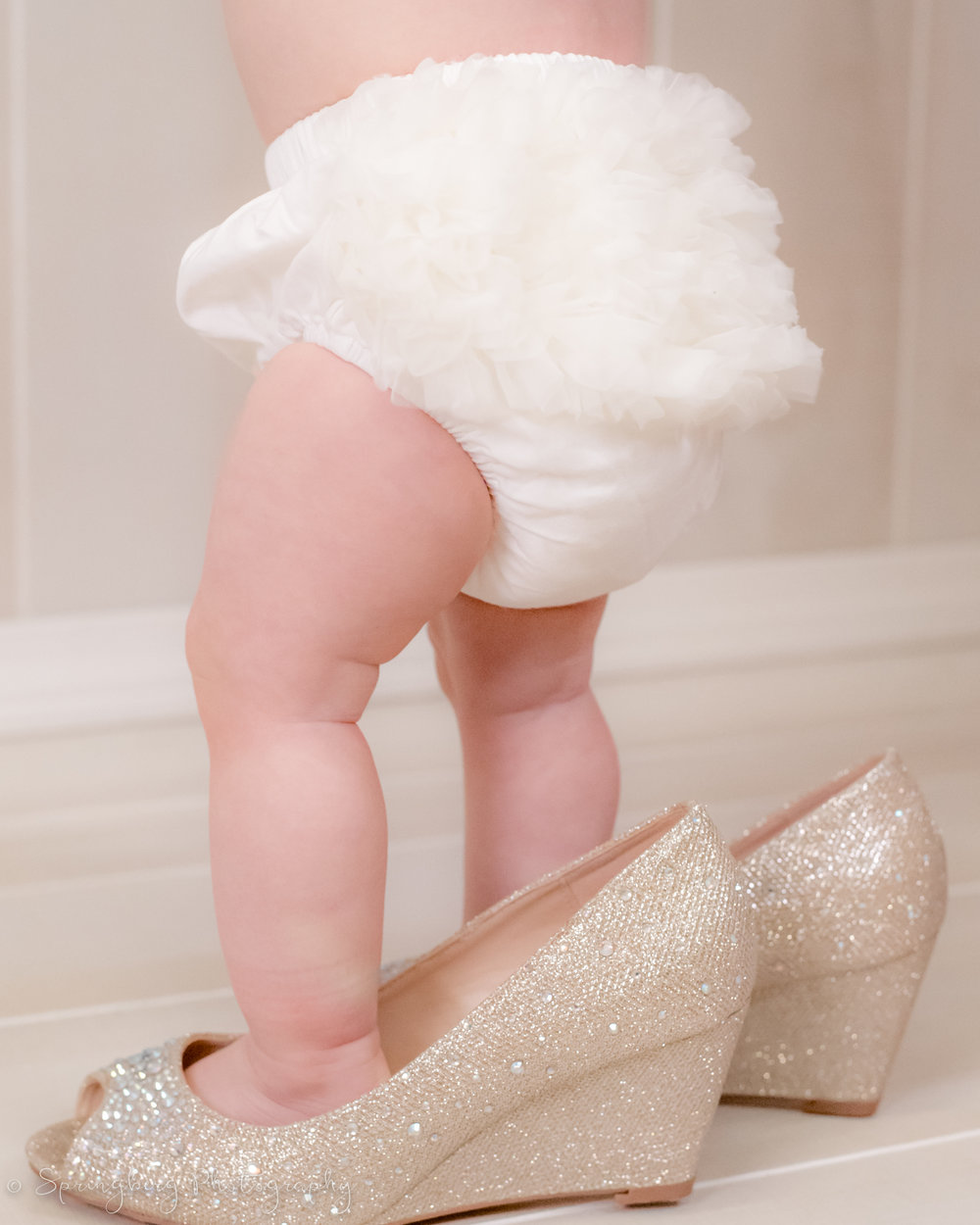 Just think: seeing how tiny her little feet once were in mama's wedding shoes will be so special when she grows up!