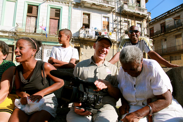 Director Jon Alpert (center wearing a cap) on the set of 'Cuba and the Cameraman'.