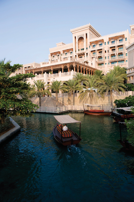 PHOTO COURTESY OF JUMEIRAH GROUP  An abra passing in front of the Al Qasr hotel