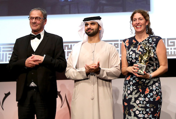 PHOTO BY VITTORIO ZUNINO CELOTTO/GETTY IMAGES FOR DIFF  Palestinian director Annemarie Jacir (R) secured the Muhr Best Fiction Feature award for 'Wajib', photographed here with actor Mohammad Bakri (L) and HH Sheikh Mansoor bin Mohammed bin Rashid Al Maktoum at the Muhr Awards
