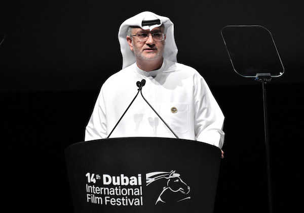 PHOTO BY NEILSON BARNARD/GETTY IMAGES FOR DIFF  DIFF Artistic Director Masoud Amralla Al Ali speaks onstage during the Opening Night Gala of the 14th annual Dubai International Film Festival held at the Madinat Jumeriah Complex