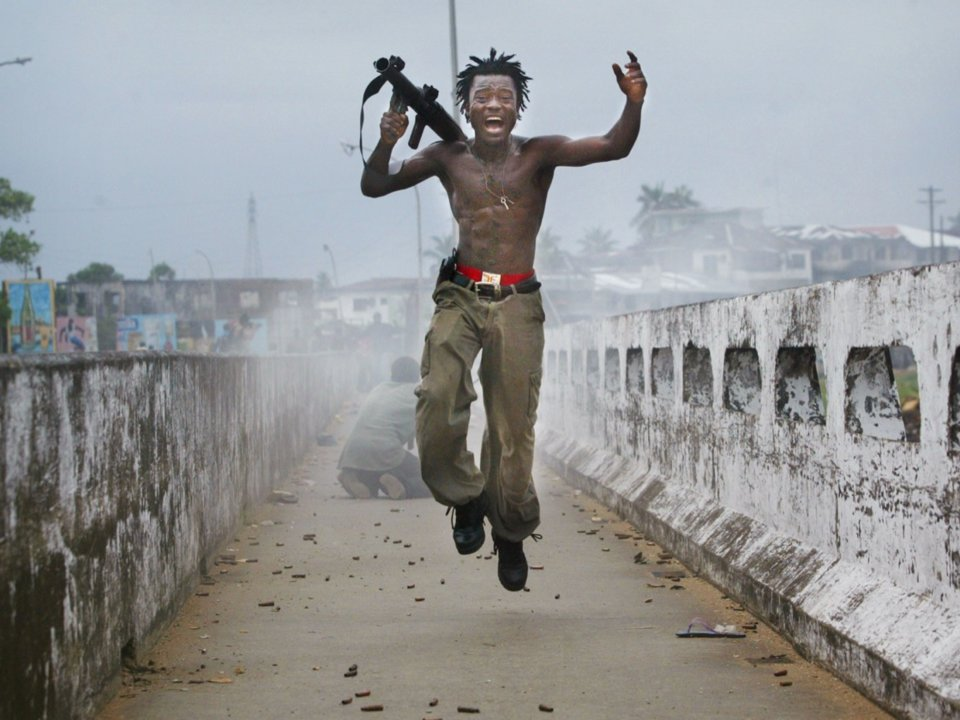 Chris Hondros/Getty Images; Courtesy of HONDROS Film