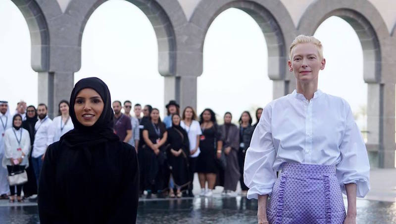 Doha Film Institute's CEO Fatma Al Remaihi and Tilda Swinton pose at the Museum of Islamic Art -- with the Qumra 2018 projects filmmakers in the background.  Photo courtesy of DFI