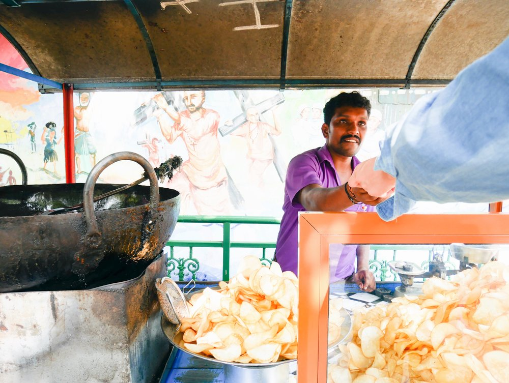 What a spirit this guy was!Freshly fried (tapioca) chips dusted in salt and chilli powder from a street vendor in Fort Kochi