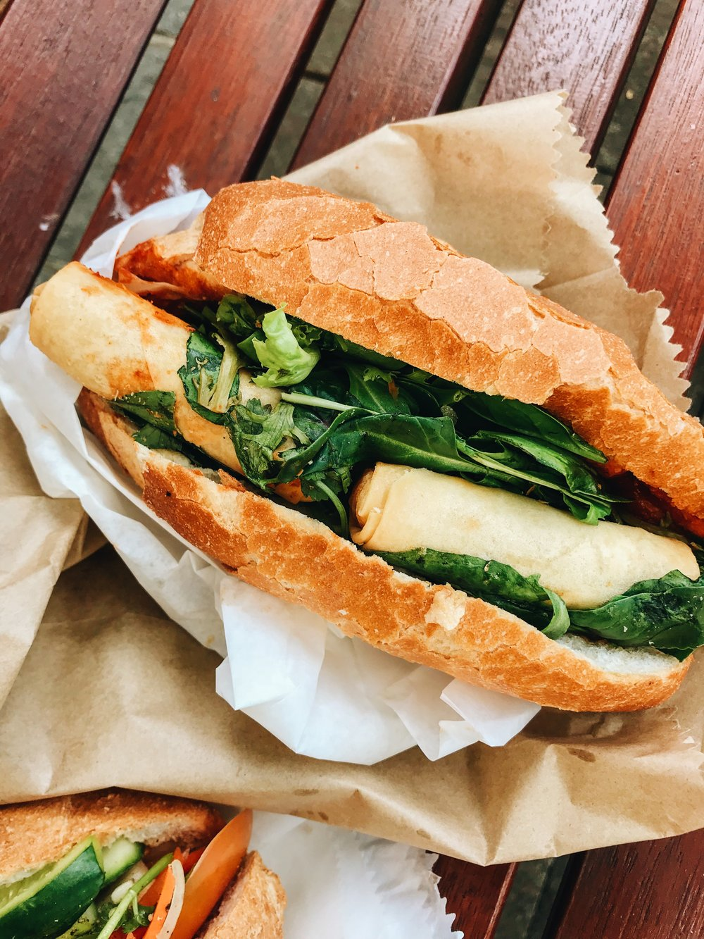 Spring Rolls in Banh Mi? Find it at OBUNMEE, Pyrmont. Also features cooked cabbage, mushroom chinese veg.