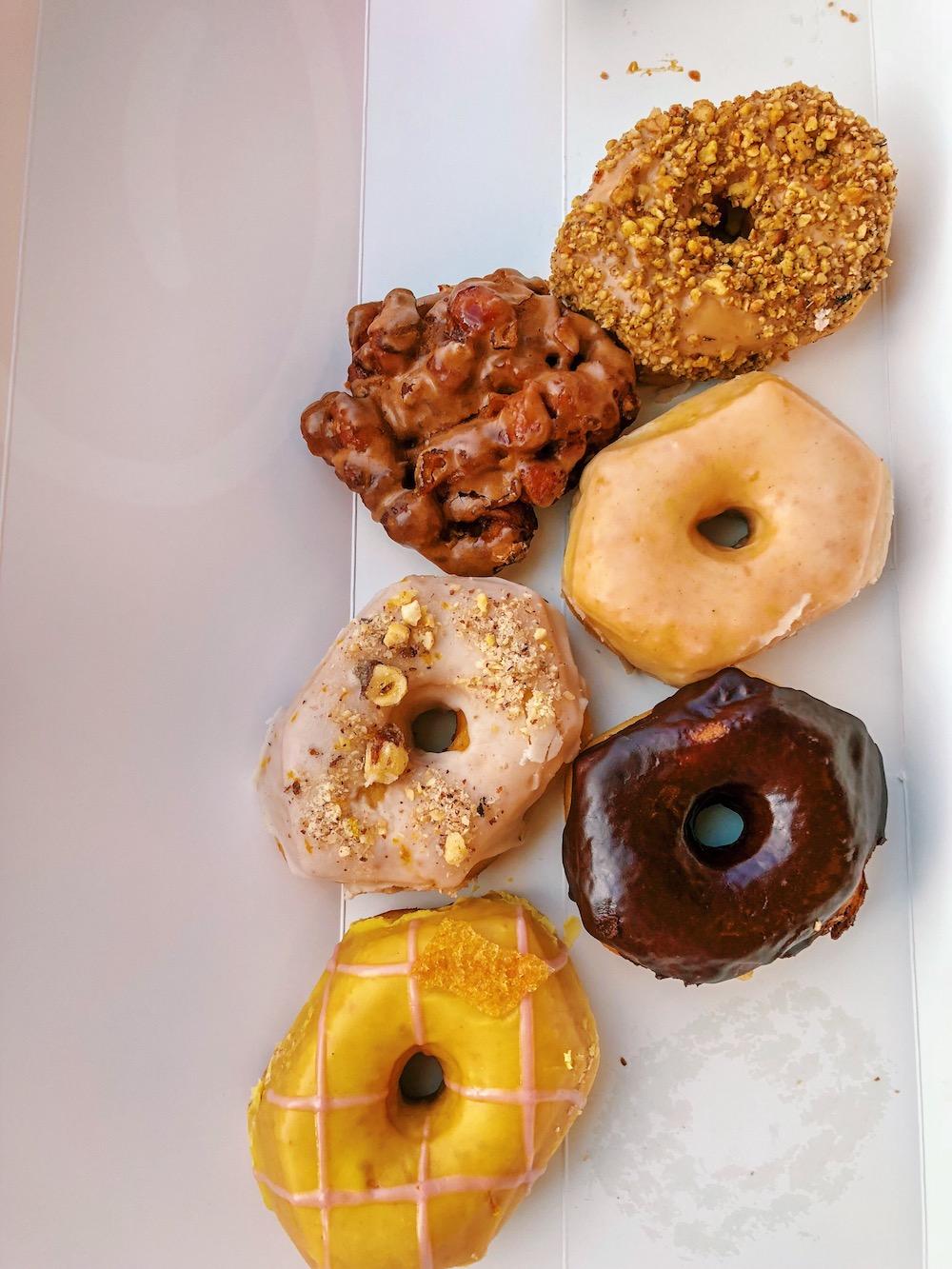 Apple Fritter, Candied Nut and Orange, Citrus Glaze, Smokes Maple Walnut, Vanilla Glaze, Chocolate Glaze from   CARTEMS