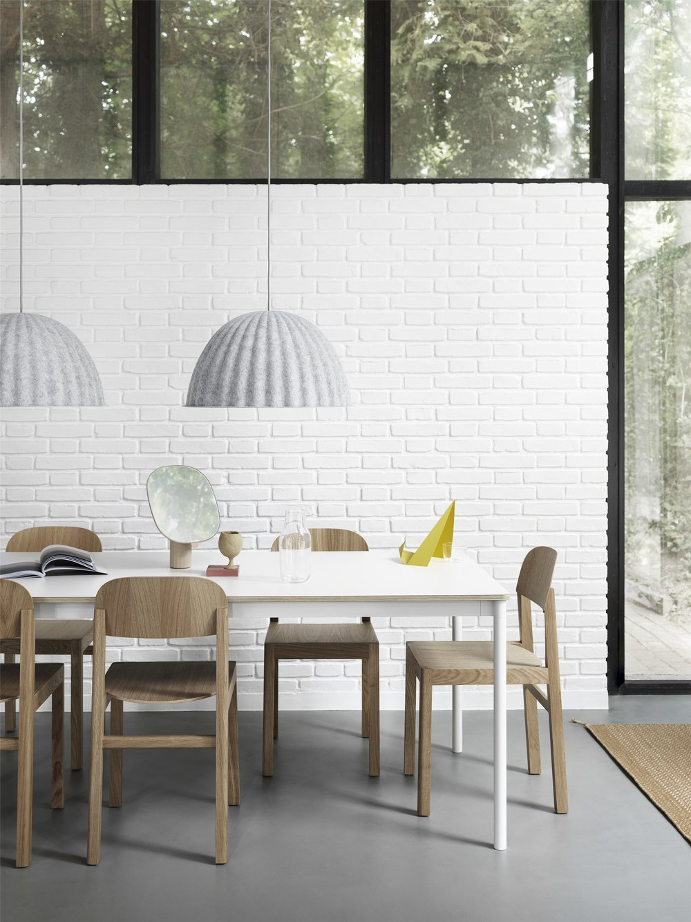 - With its raw and distinct surface texture, the lampshade adds a modern sentiment to its surroundings while absorbing the sound underneath with its distinct form.