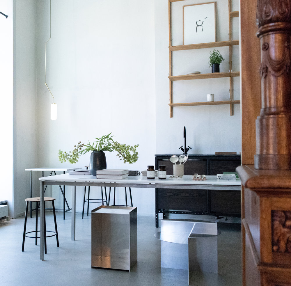 - Modern minimal contours contrast with the old original furniture from the old days.