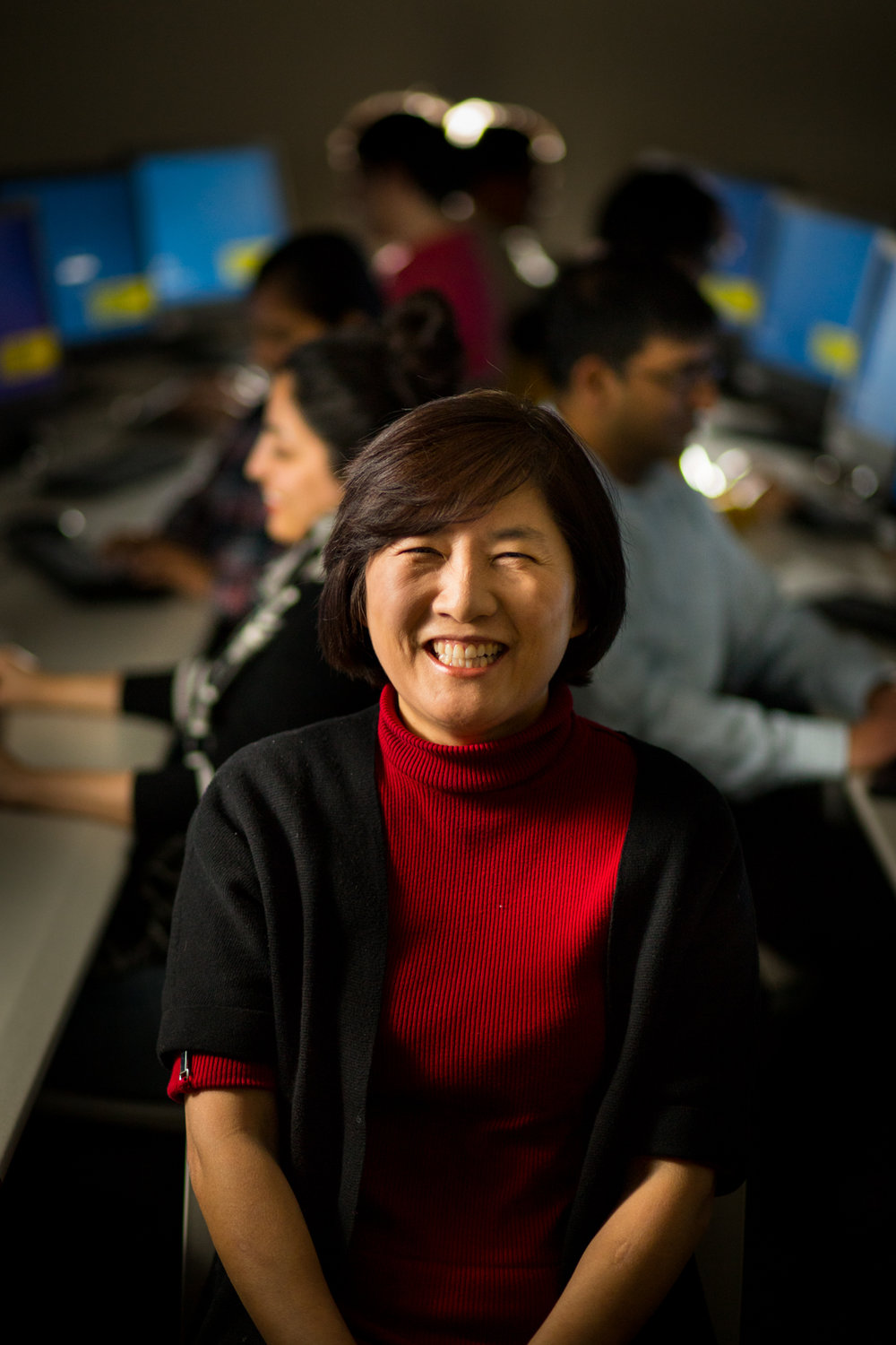 SCE Dr. Lee portrait in computer lab with students-7-6710.jpg