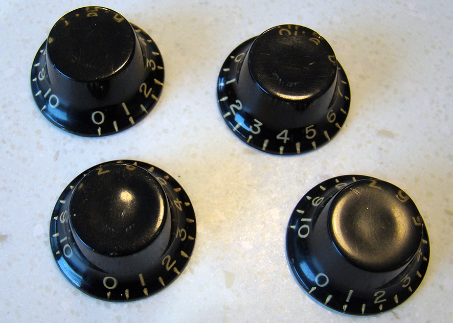 BLACK BONNET KNOBS  Hard to find, matched set of four Black Bonnet Knobs in perfect original condition, with no cracks, repairs or damage. Used on 1955-58 Les Paul Specials and TV models. We also have matched pairs for Juniors and TV models from this era.    Price: POA