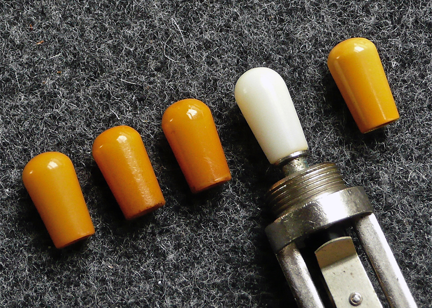 AMBER SWITCH TIP  Another impossible to find part. Although there are now some good replica switch tips available they just don't have the same look and feel of the original amber catalin tip. No cracks or chips, a perfect examples.     Price: POA
