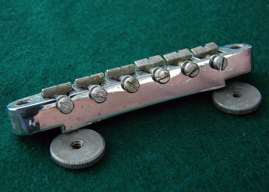 ABR-1 NON-WIRE BRIDGE  We have a couple of these rare, early non-retaining wire bridges available. They are complete with original saddles and intonation screws. Many of the original bridges have 'sunk' (bowed downwards under years of string tension) which makes them unusable. These are  guaranteed  perfectly straight and 100% functional.    Price: POA
