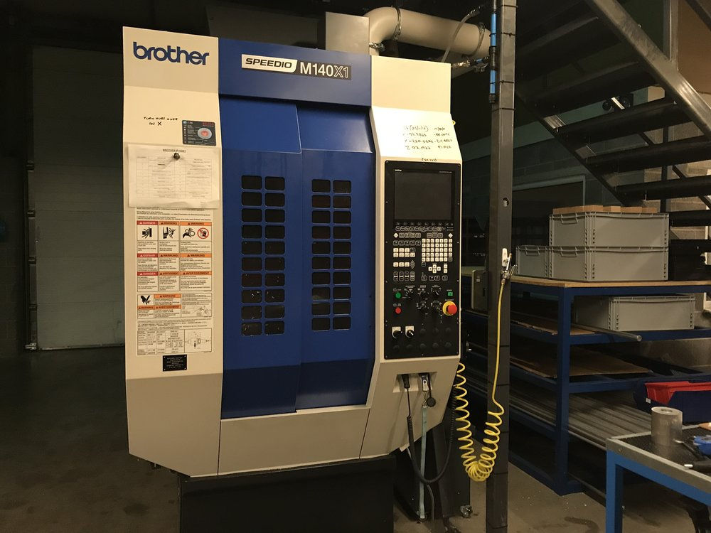 Brother Speedio M140X1 - A unique combination of ultra fast 5 axis milling machine and turning capability on one fixture. High speed 16,000RPM milling spindle and robot loaded automated cell for 24/7 running.Specifically bought for manufacturing complex hub shells with high added value complexity, it has a capacity of up to 300 hub shells per shift.