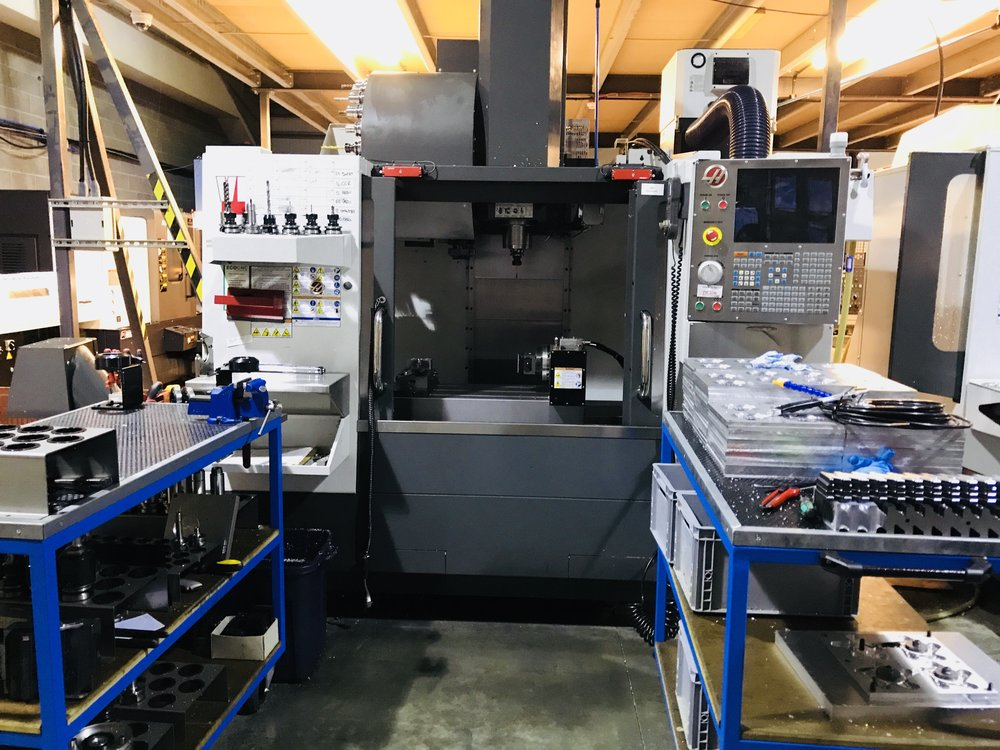 Haas VF2SS - 4th axis - High speed 12,000RPM milling machine with 4th axis for manufacturing complex components. Fitted with a zero point system for fast and ultra accurate setup of a range of vices to suit your component.We manufacture tooling and small components on this machine.