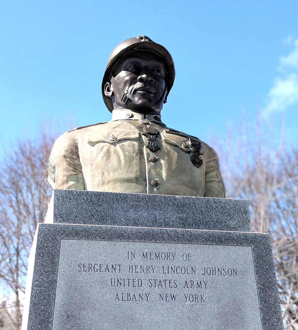 "Sgt. Henry Johnson statue bust. Arbor Hill neighborhood, Albany, NY.  Note: Johnson's regiment — the 369th Infantry Regiment, formerly known as the 15th New York National Guard Regiment, also known as the ""Harlem Hellfighters""— wore the  French Adrian helmet , not the  Brodie helmet (or doughboy helmet)."
