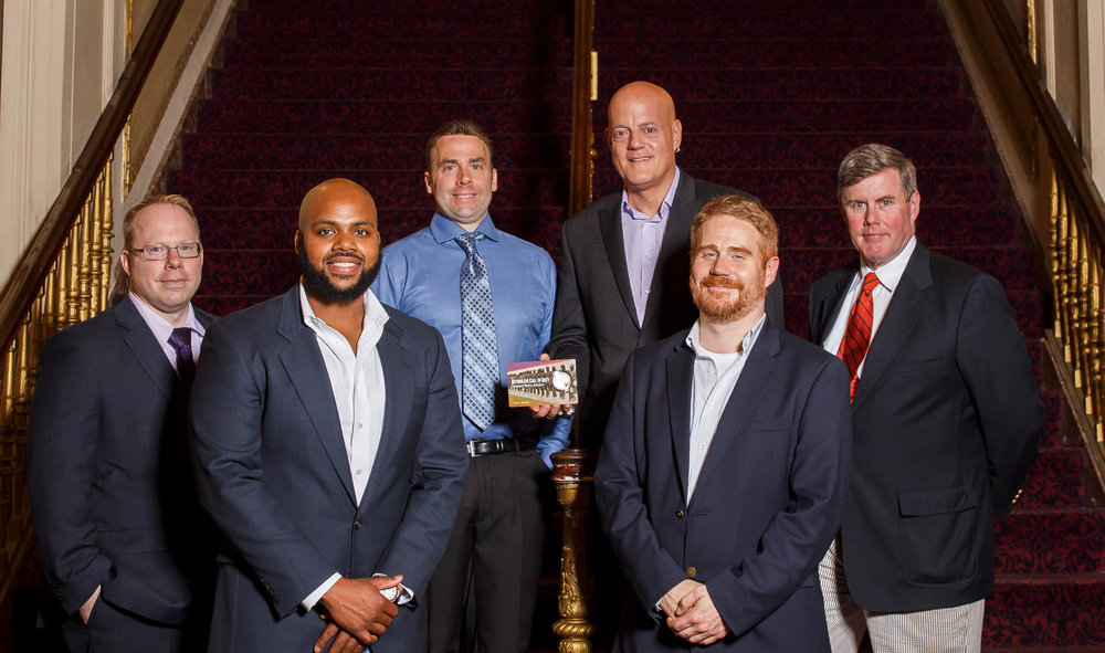 (From left to right, Mike Dozois, Ferris Coin Co. managing partner, Jahkeen Hoke, 2018 recipient of the Henry Johnson Award, Geoff Demis, Ferris Coin Co. president,  Chris Costello, artist,  Duncan Crary, Ferris Coin Co. communications, Jim Naughter, Ferris Coin Co. partner. )