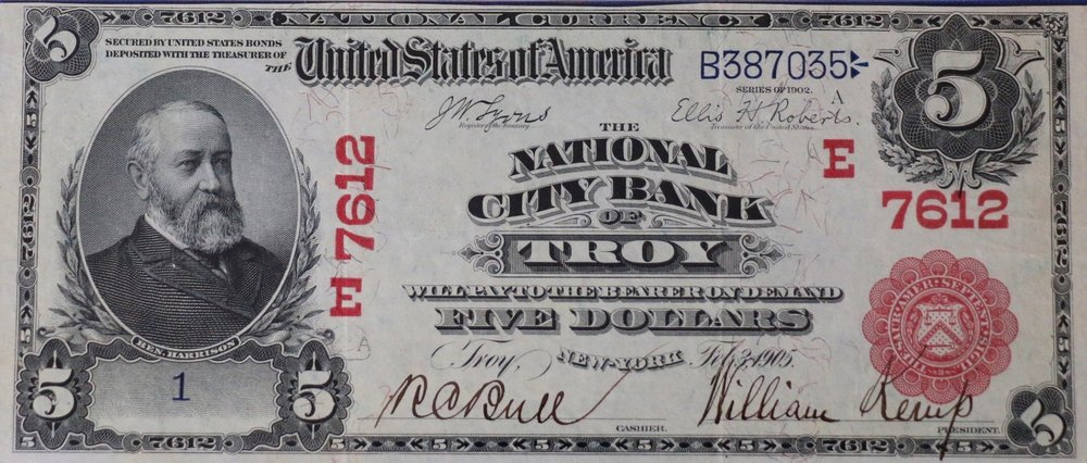 1902 $5 bill issued by The National City Bank of Troy with rare red seal, printed from plate number 1A. The note is counter signed by bank Cashier Rice C. Bull.