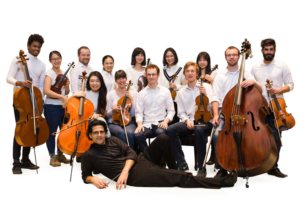 Amit Peled with his former students, The Mount Vernon Virtuosi. The ensemble brings classical music to the community.