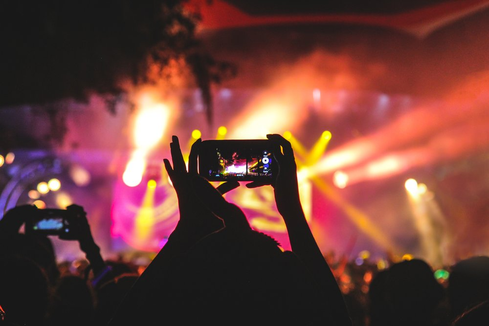 Festival-goers record performance and share experiences