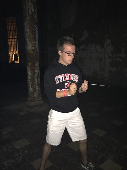 Cameron uses dowsing rods to connect with alleged spiritual energy at The Ohio State Reformatory