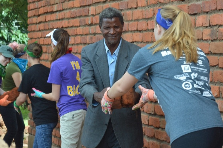 Otterbein students help locals construct the Cardinal Classroom in Lilongwe, Malawi