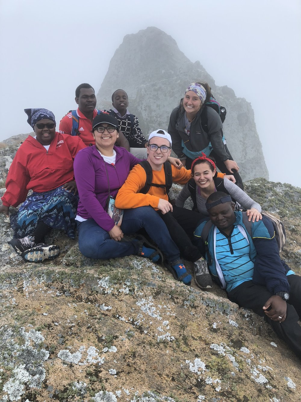 Nyathipa, Ernest, Mwenecho and Justice pose with students at the top of Mount Nkhoma
