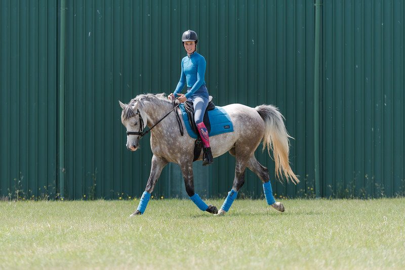 Lara Beth rides flat work with Snow White.