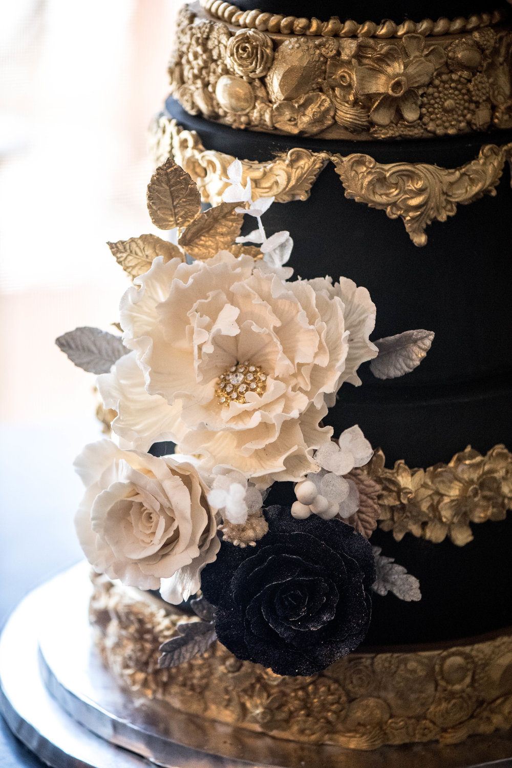 Black and gold wedding cake created for a luxury Virginia wedding