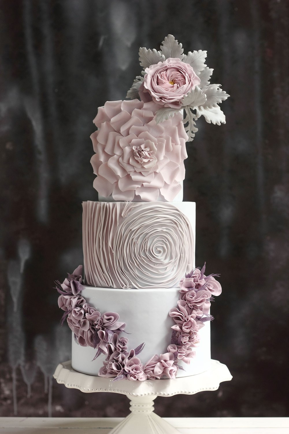 Cake by Jessica MV of Floral Cakes by Jessica MV - A custom design like this one takes hours of labor, and years of expertise. Ruffles are beautiful, but it can take upwards of 10-12 hours to cover a single cake tier.