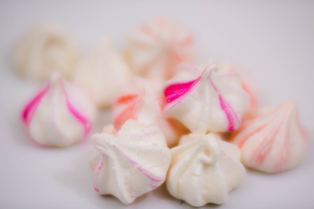 To stripe the meringues, turn the piping bag inside out and paint on stripes before filling. -