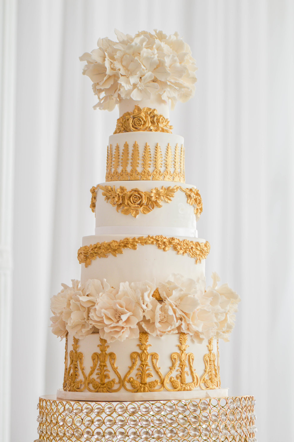 """Beautiful, Elegant, Delicious - """"Rebekah created a piece of perfection for our special day! Our guests raved about the gorgeous cake, which was over 10-tiers and covered in beautiful hand-crafted sugar flowers. She is an artisan of cake!!""""Sabine Asante"""