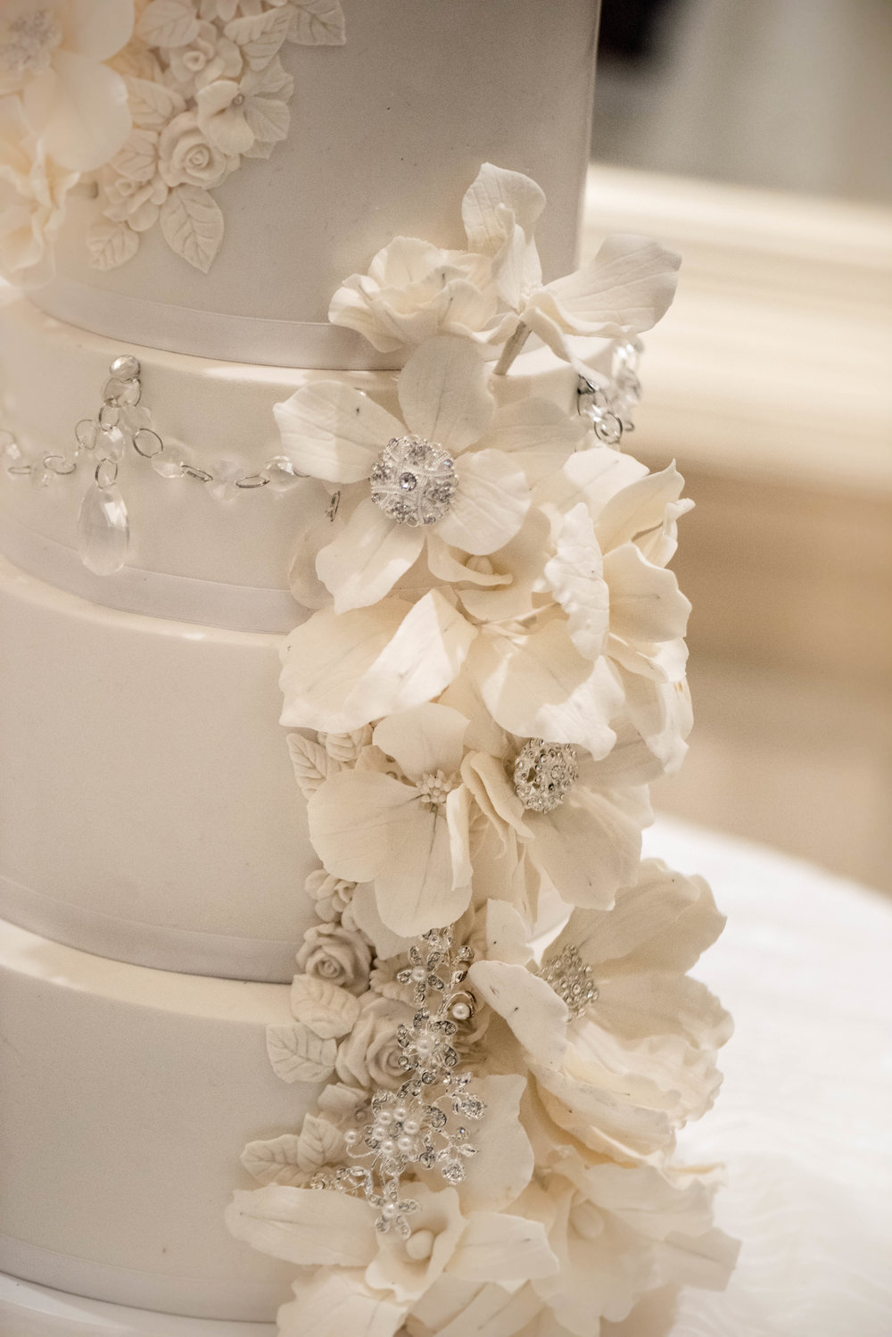 The sugar flowers were accented with Swarovski crystals -