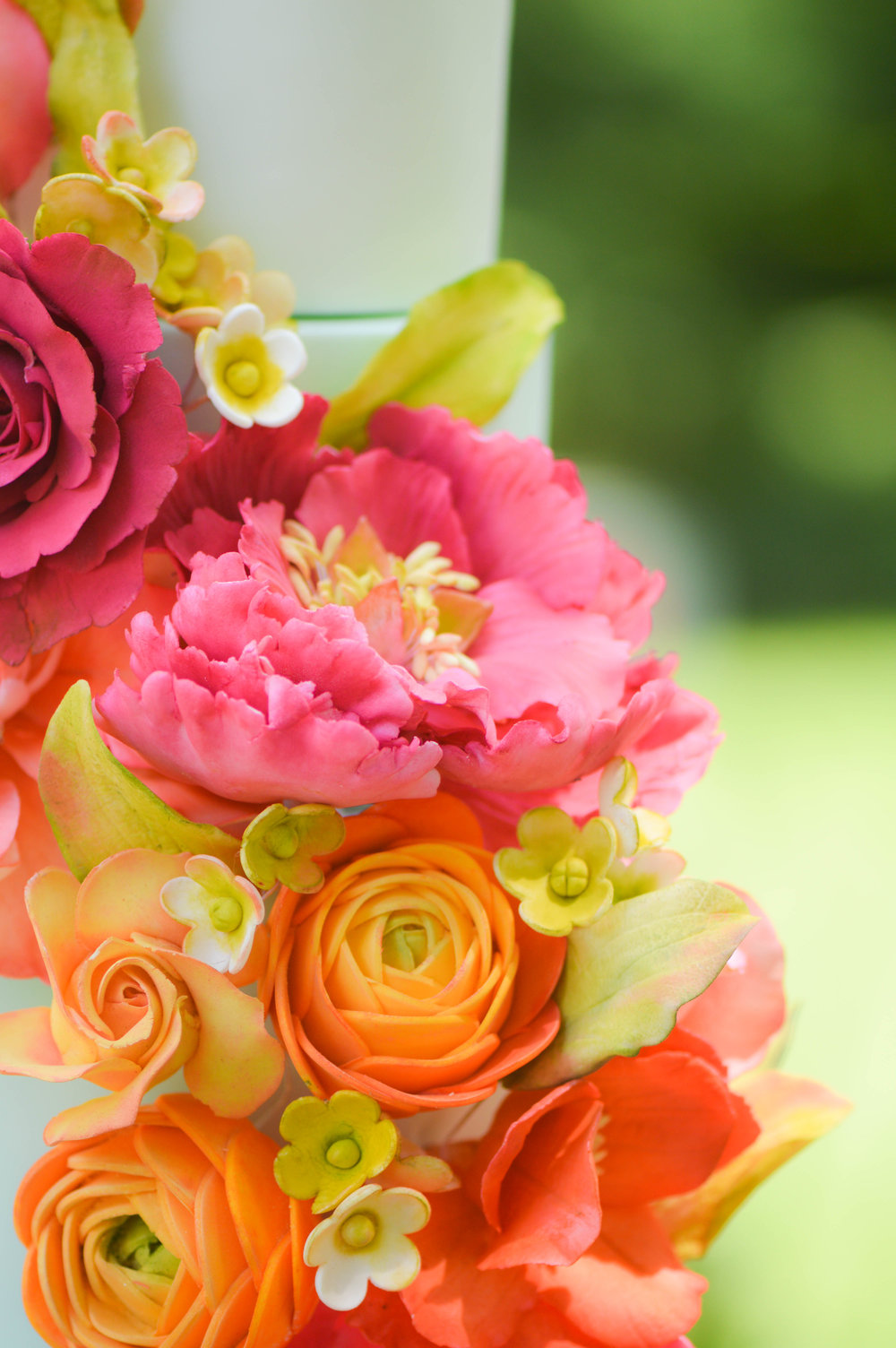 The bouquet incorporated the brides favorite flowers. - Ana loved Peonies, Roses and Ranunculus, which were all incorporated into the arrangement.