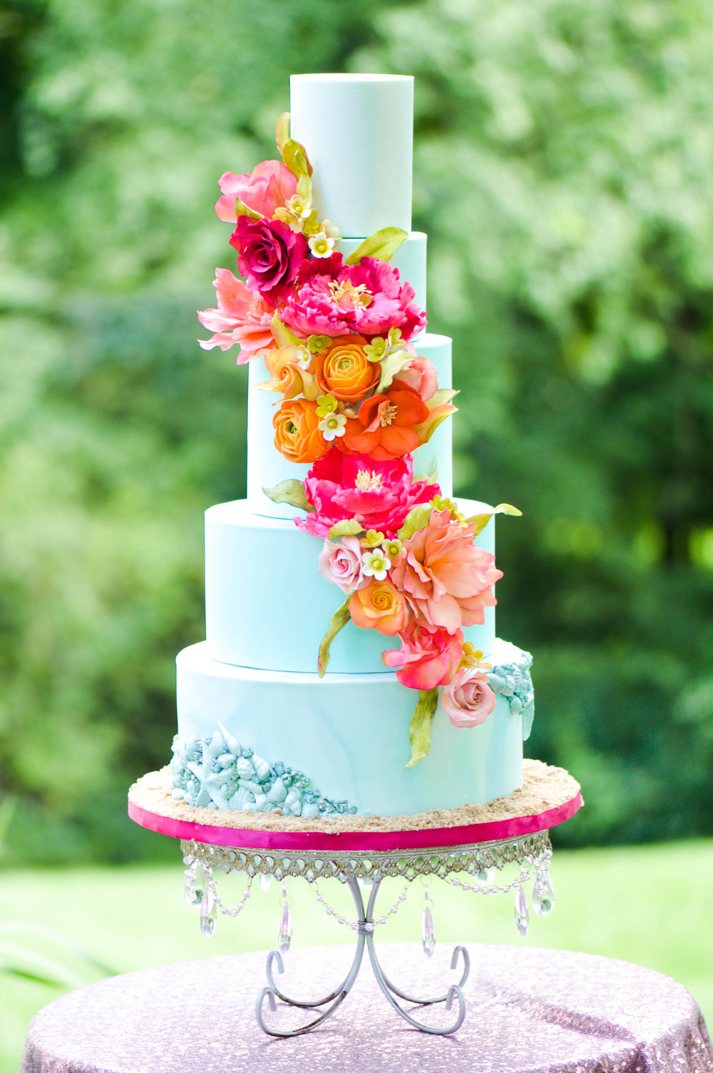 Dazzling Blues - The cake featured an ombre blue color palette and bold colorful blossoms for a tropical feel.