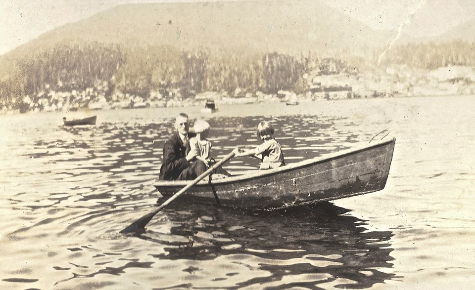 Ed Sande and children on a row along the Ketchikan waterfront in 1927.