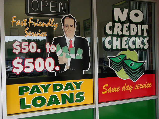 """ Payday Loan Place Window Graphics "" by  Taber Andrew Bain  is a Creative Commons image, licensed under  CC BY 2.0"