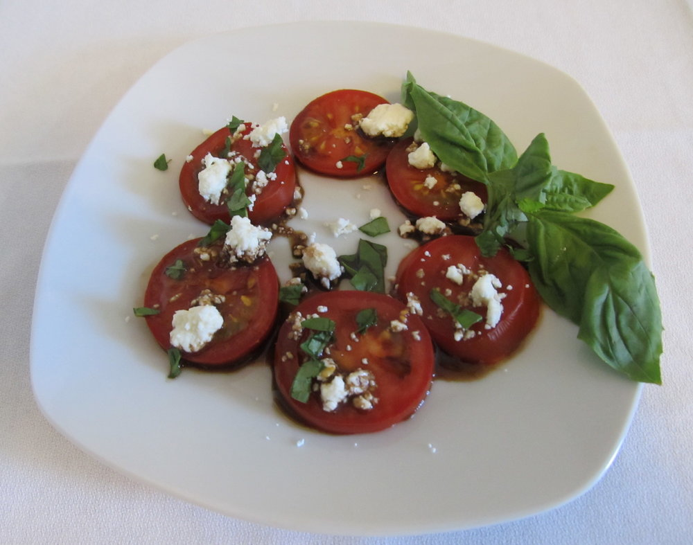 Backyard Farms tomatoes with fresh basil and goat cheese