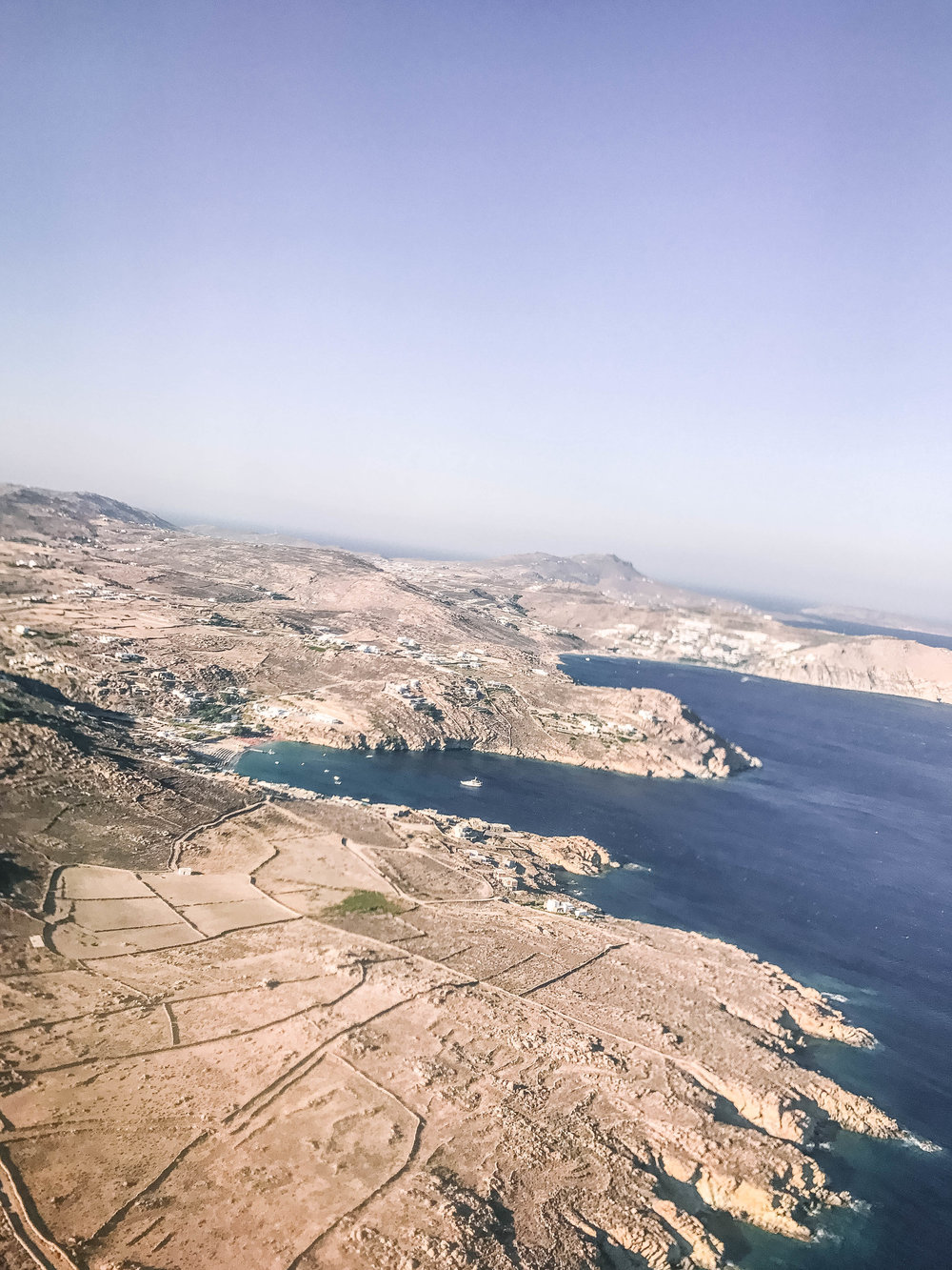 mykonos,greece - the view from the plane is where the trip begins. follow my mykonos adventures through these photos