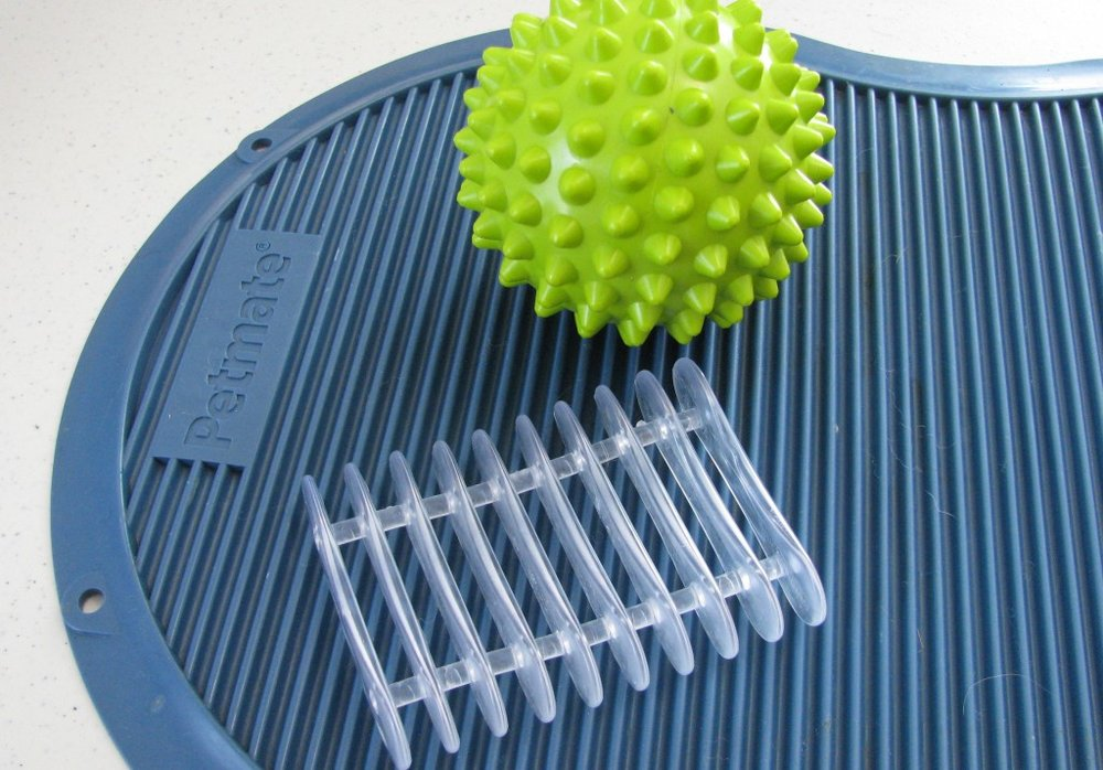 Ribbed surface (pet food tray), exercise ball, soap dish