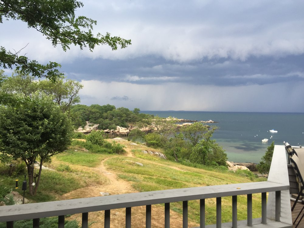 Another view from the deck — rain over Ipswich Bay
