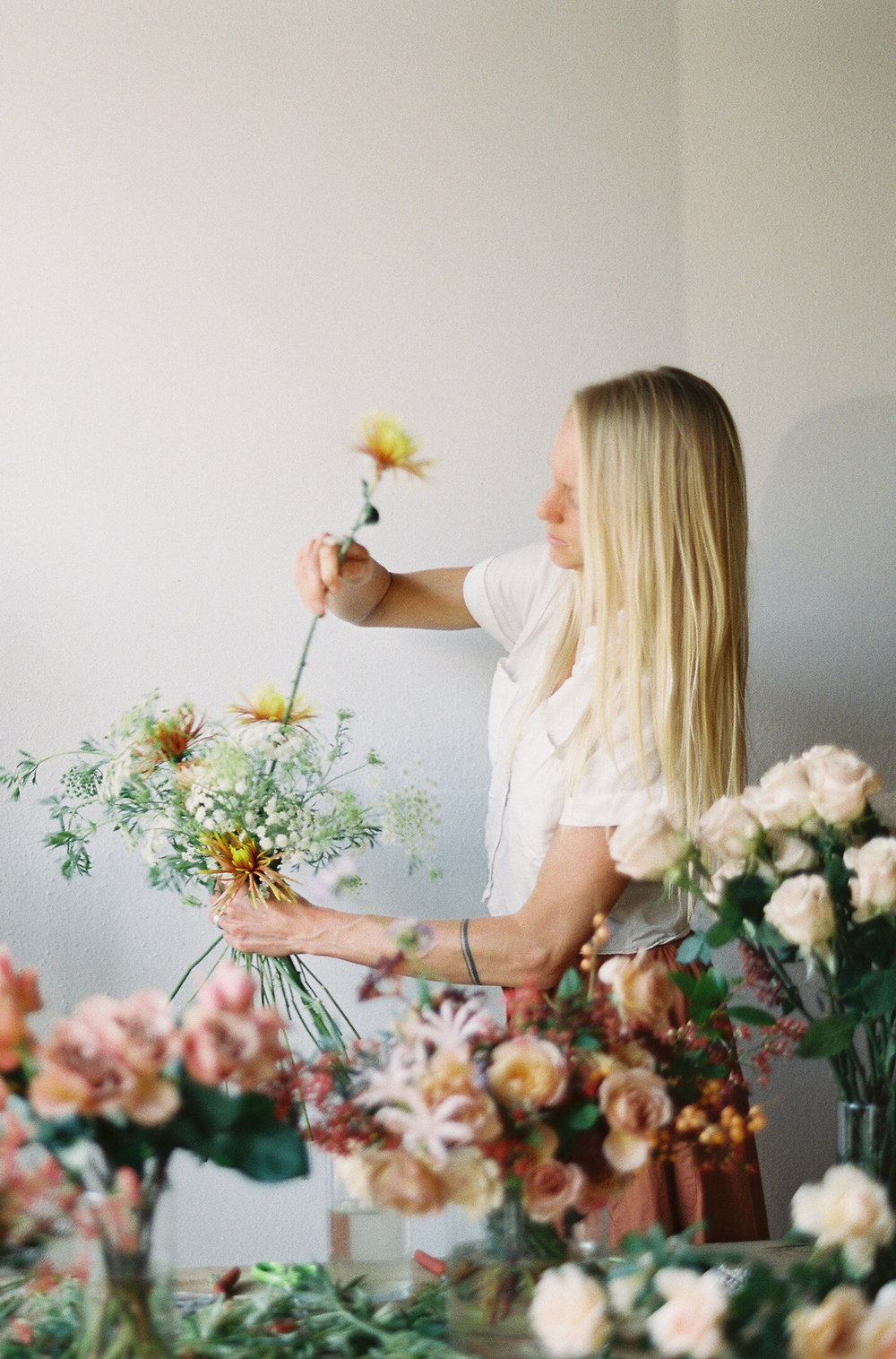 NECTAR + BLOOM || Bridal Bouquet of Wild Flowers + Mums + Garden Roses in Process  || Sposto Photography || #fineartweddingflowers #fineartfloraldesign #fineartwedding #sandiegoweddingflorist #sandiegoflorist  #sandiegofloraldesigner #fineartweddingbouquet #bridalbouquet #bridalstyle #romanticwedding #weddingdetails #modernbride #modernbrialbouquet #bohemian #elegantbride #weddingfashion #fallbridalbouquet #autumbridalbouquet #fallflowers #gardenroses #romanticwedding #romanticbridalbouquet