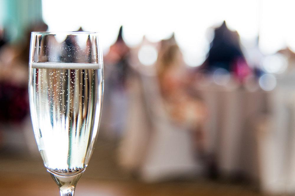 Champagne at the beach in Devon Wedding Venue.jpg