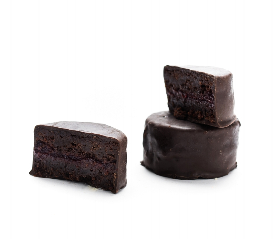 Nick's Pick (GF)   The pick of the litter. Our densest, darkest flourless (and naturally gluten-free) chocolate cake, wrapped in dark chocolate coating and cut with a tangy layer of raspberry jam. Named after Ring Ding Bar Founder and Chef Madeline Lanciani's son Nicholas Rotondi!