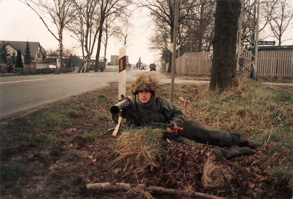 Drecks in ambush position near a road crossing in Germany, 1987. Notice the Uzi!