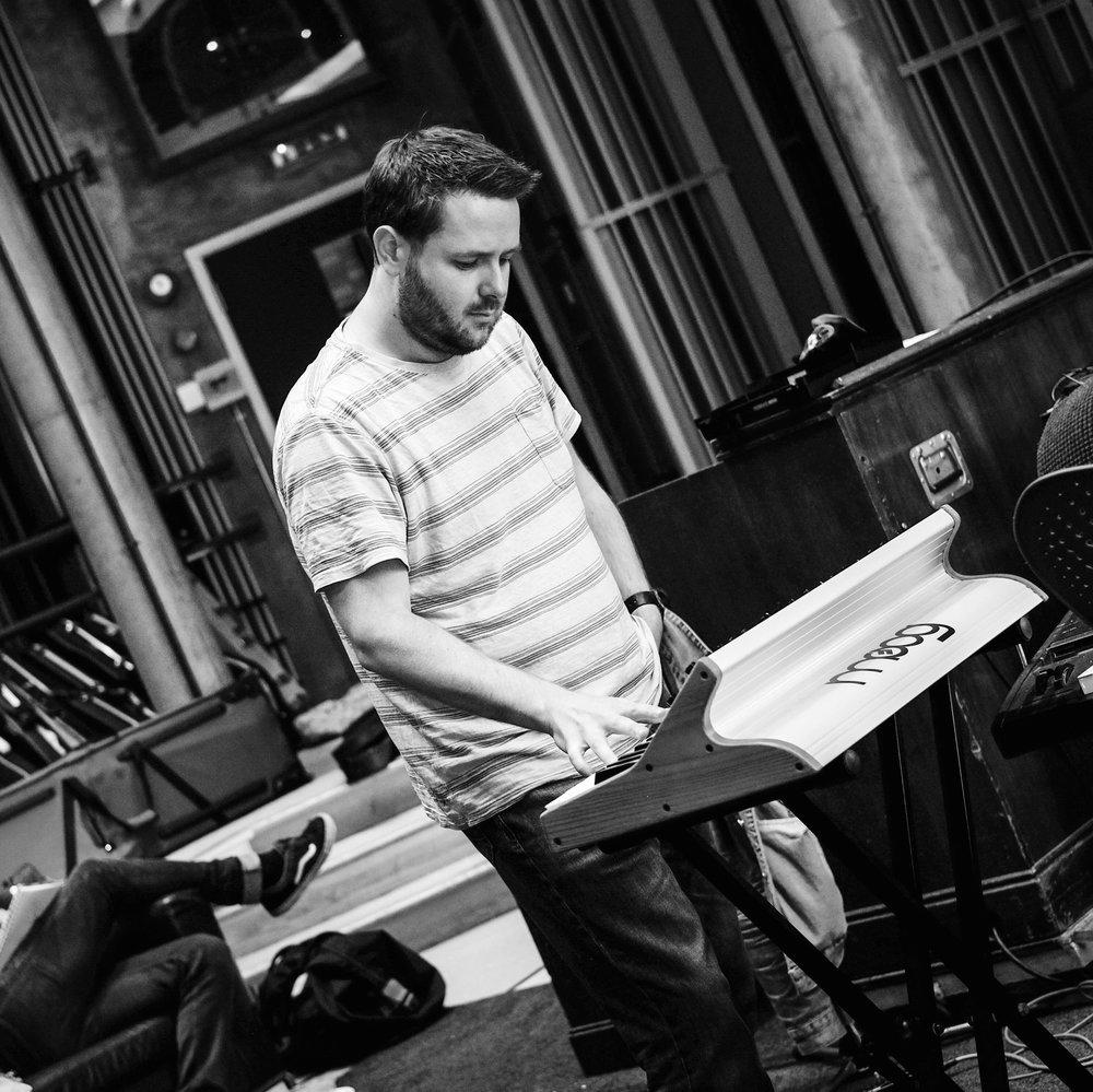 Aaron Dunne - bass guitar/moog